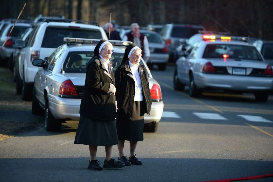 Two unidentified nuns on December 14, 2012 leave the scene at the aftermath of  a school shooting at