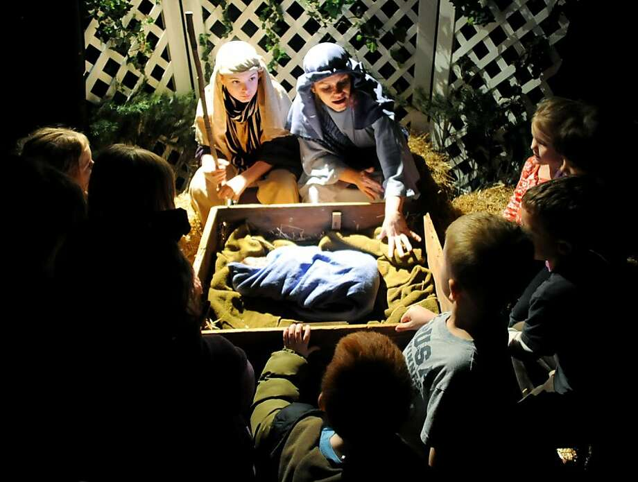 And then came the shepherds on high and visiting wise men and herald angels - whew. Busy night in the stable:Joseph and Mary discuss the baby Jesus with preschoolers from Pleasant Grove Christian Learning Center at Lewis Lane Baptist Church in Owensboro, Ky Photo: Gary Emord-Netzley, Associated Press