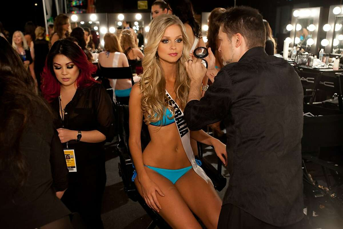 Excuse me while someone powders my nose: Miss Australia Renae Ayris has her makeup done for the Miss Universe Presentation Show in Las Vegas. The 89 Miss Universe contestants will compete for the Diamond Nexus Crown on Dec. 19.