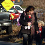 After a horrific shooting at Sandy Hook Elementary School nearby, parents and children leave the Sandy Hook Firehouse where they gathered for news about their children in Newtown, Conn. on Friday December 14, 2012.