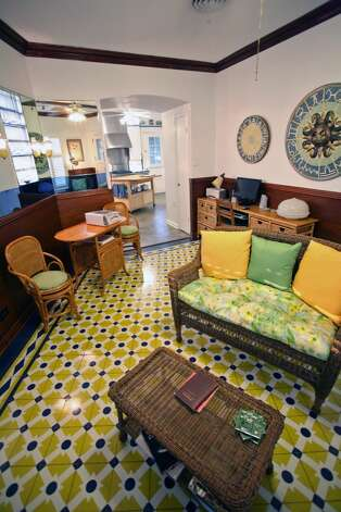 The yellow, blue and white cement tile in the breakfast room/den was installed 72 years ago. (Danny Warner)