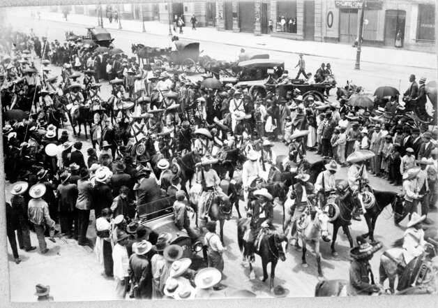 Zapata's troops gather on a main street in Mexico City.