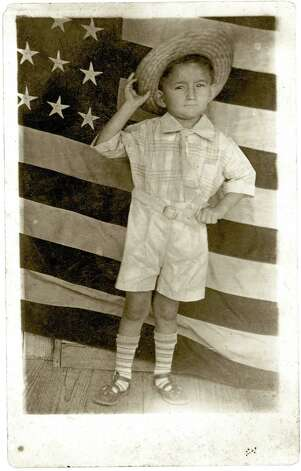 Jose Heberto Ramirez posed for this patriotic photo with an American flag in 1930.