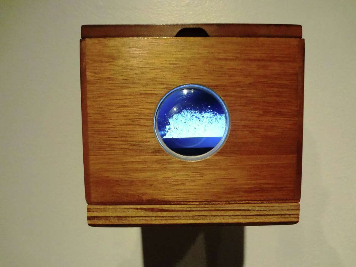 Into small birdhouselike boxes, San Antonio artist Justin Boyd captured sounds and imagery from the San Antonio River for