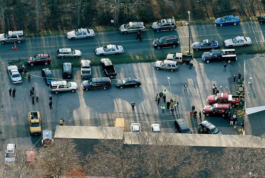 People gather at a fire station that was set up as a triage area near the scene of a mass school shooting at Sandy Hook Elementary School on December 14, 2012 in Newtown, Connecticut. Photo: Mario Tama, Getty Images