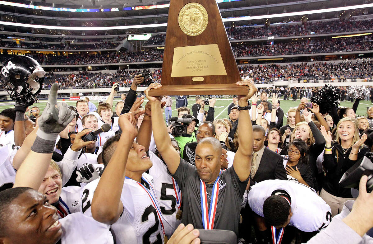 Cibolo Steele Knights' head coach Mike Jinks holds up the trophy after his team defeated the Denton Guyer Wildcats 24-21 in the Class 5A Division II state final Saturday Dec. 18, 2010 at Cowboys Stadium in Arlington, Tx. (PHOTO BY EDWARD A. ORNELAS/eaornelas@express-news.net)
