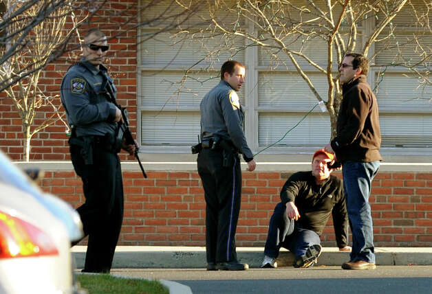 After a horrific shooting at Sandy Hook Elementary School nearby, police respond to St. Rose School after a lockdown at the school in Newtown, Conn. on Friday December 14, 2012. Photo: Christian Abraham / Connecticut Post