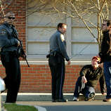 After a horrific shooting at Sandy Hook Elementary School nearby, police respond to St. Rose School after a lockdown at the school in Newtown, Conn. on Friday December 14, 2012.