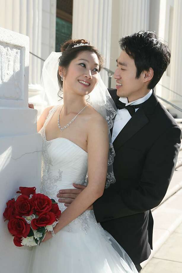 Sarah Kim and her fiance is Joo-Hyung Yi from Santa Clara are getting married on 12-12-12 because her parents got married on 11-11 at 11:11 in 1976. Photo: David Hwang At Studio Memories