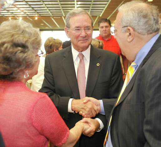 Lamar University held a press conference Friday August 3, 2012 to formally announce the retirement of President James Simmons.  After meeting with the local media, he then was greeted and congratulated by faculty, staff, and friends.  Dean Russ Schultz, right, College of Fine Arts and Communications shook his hand in congratulations.  Simmons made it official with the effective date of January 31, 2013 being his last day.  Dave Ryan/The Enterprise