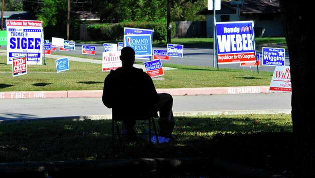 It's Election Day and over at Precinct 77,  the North End Community Center, Cameron Alexander, was taking a break underneath a shade tree.  He was standing in the parking lot showing his support for Mickey Shuffield and waving his sign at passing cars.   Dave Ryan/The Enterprise