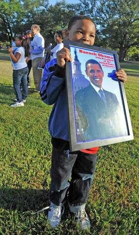 It's Election Day and over at Precinct 75, the Alice Keith Park Recreation Center, seven year old Darryl Harrington was proudly carrying around a framed portrait of President Obama.  Dave Ryan/The Enterprise