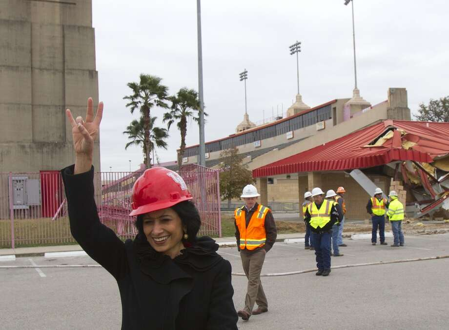 UH president Renu Khator shows her Cougar support after getting to operate an excavator during Robertson Stadium's demolition on December 10. (Cody Duty / Chronicle)