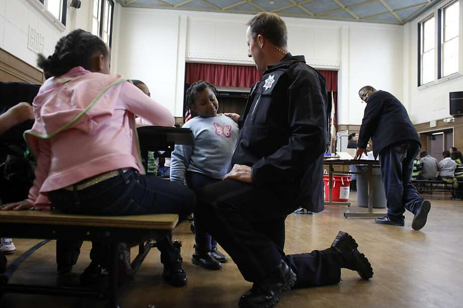 In response to the tragedy in a Connecticut elementary school killing 26 people Oakland Police Officer Rick Moore spends more time than usual talking with students, at Piedmont Avenue Elementary School,   Friday Dec. 14, 2012, in Oakland, Calif. Photo: Lacy Atkins, The Chronicle