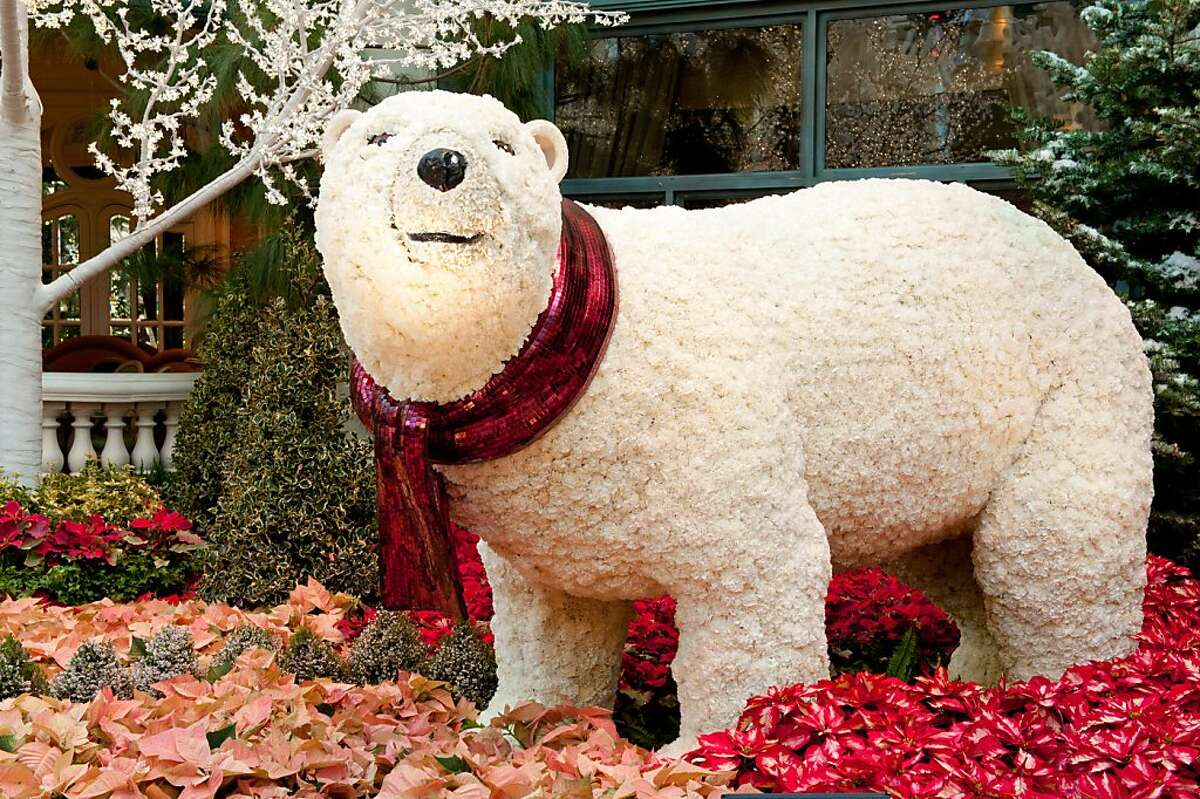 Polar bears made of thousands of white carnations are part of the holiday display on view through Jan. 5 at Bellagio in Las Vegas. The exhibition in the Conservatory & Botanical Gardens includes more than 50,000 flowers and 350 plants and shrubs.