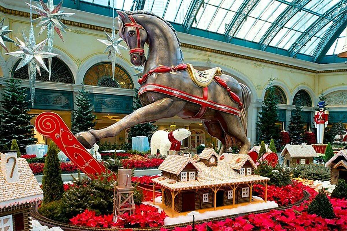 A seven-foot rocking horse stands over a handmade chocolate village crafted by Bellagio's pastry chefs in the Las Vegas resort's Conservatory & Botanical Gardens.