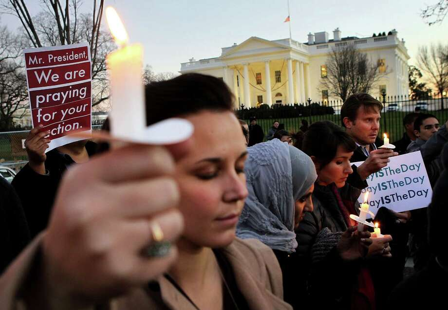 WASHINGTON, DC - DECEMBER 14:  People gather outside the White House to participate in a candle light vigil to remember the victims at the Sandy Hook Elementary School shooting in Newtown, Connecticut on December 14, 2012 in Washington, DC.  According to reports, there are about 27 dead, 18 children, after a gunman opened fire in at the Sandy Hook Elementary School. The shooter was also killed. Photo: Alex Wong, Getty Images / 2012 Getty Images