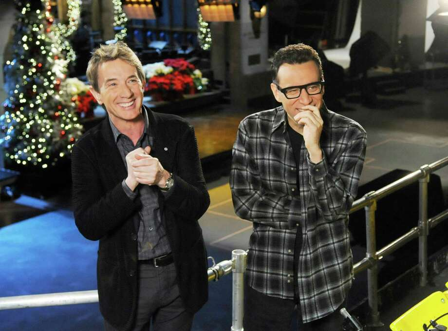 "This Dec. 11, 2012 photo released by NBC shows Martin Short, left, with cast member Fred Armisen on the set of ""Saturday Night Live,"" in New York. Short will guest host on the popular late night program along with musical guest Paul McCartney. (AP Photo/NBC, Dana Edelson) Photo: Dana Edelson, HOEP / NBC"