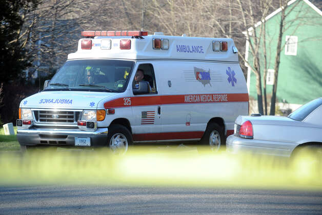An ambulance leaves a house on Yogananda Street in Newtown, Conn., where the mother of shooting suspect Adam Lanza was found shot to death on Friday, Dec. 14, 2012. Photo: Ned Gerard / Connecticut Post