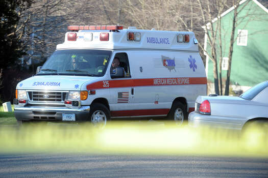 An ambulance leaves Yogananda Street, in Newtown, Conn., where one adult was found dead in a home following the mass shooting at Sandy Hook Elementary School Dec. 14th, 2012. Photo: Ned Gerard / Connecticut Post