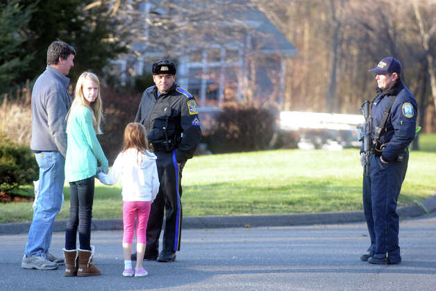 State Police speak to neighbors on Yogananda Street in Newtown, Conn., where the mother of shooting suspect Adam Lanza was found shot to death on Friday, Dec. 14, 2012. Photo: Ned Gerard / Connecticut Post