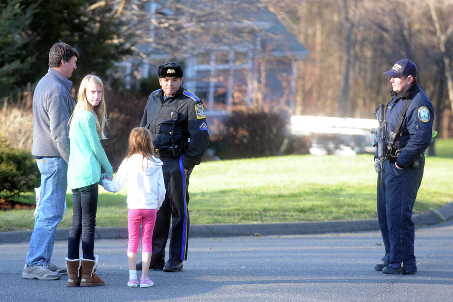 State Police speak to neighbors onYogananda Street in Newtown, Conn., where the mother of shooting suspect Adam Lanza was found shot to death on Friday, Dec. 14, 2012. Photo: Ned Gerard / Connecticut Post