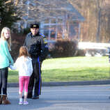 State Police speak to neighbors on Yogananda Street, in Newtown, Conn., where one adult was found dead in a home following the mass shooting at Sandy Hook Elementary School Dec. 14th, 2012.