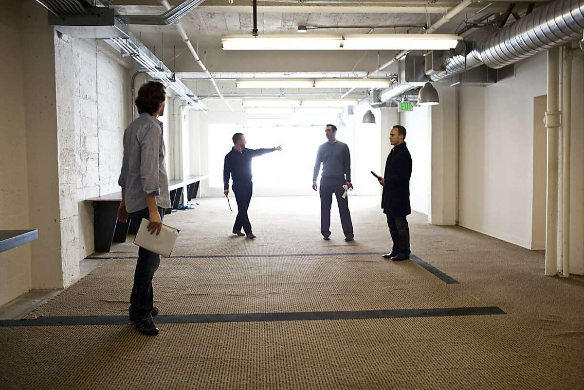 Nat Friedman, left, CEO and cofounder of Xamarin, checks out office space for his company.