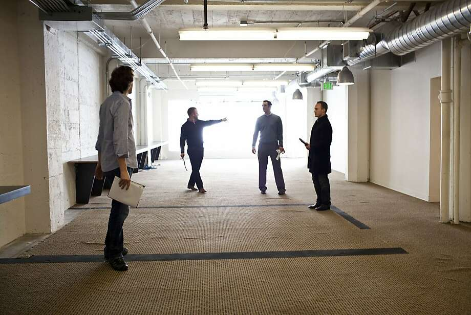 Nat Friedman, left, CEO and cofounder of Xamarin, checks out office space for his company. Photo: Jason Henry, Special To The Chronicle