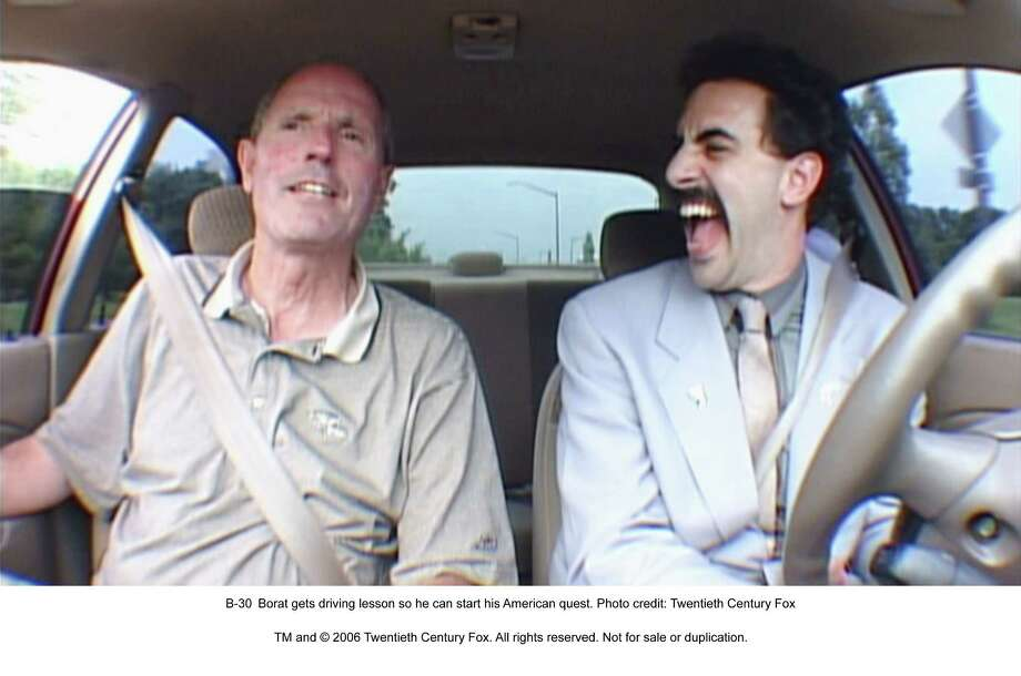 "In the movies, the driver can take his eyes off the road for minutes at a time. In this case, there's no danger as the titular character in ""Borat"" enjoys himself during a driving lesson. / handout CD"