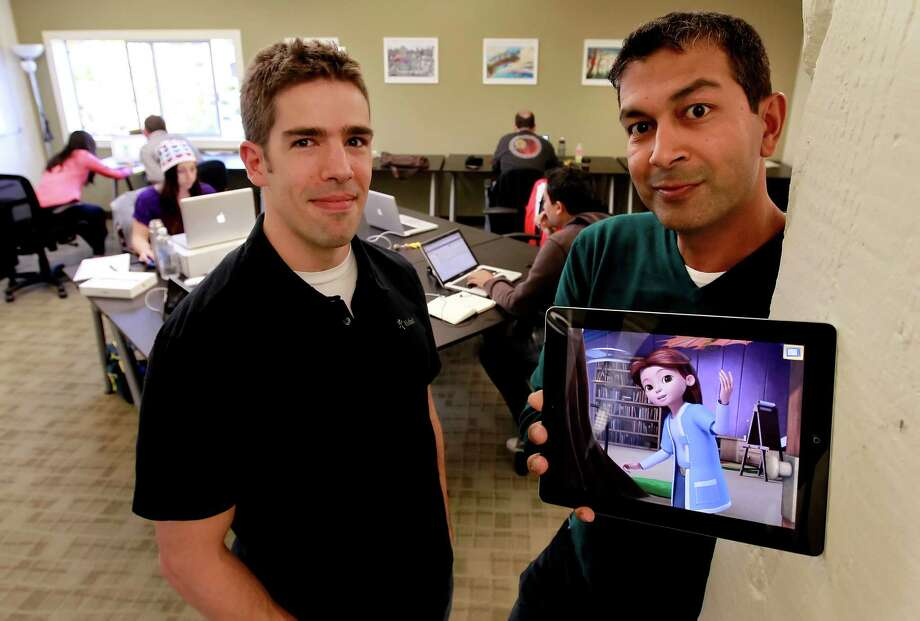 Co-founders of the company Kidaptive, Dylan Arena, (left) chief learning officer and P.J. Gunsangar, CEO with the Leo's Pad app dispayed on an iPad at their headquarters on Wednesday Nov. 21, 2012, in Palo Alto, Calif. Kidaptive the latest startup  aiming to develop educational apps for kids. It comes as more and more children are using their parent's iPads and iPhones. Photo: Michael Macor, The Chronicle / ONLINE_YES