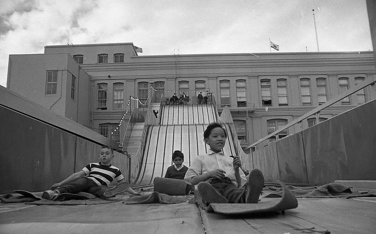 Dec. 17, 1968: Children and adults alike enjoyed the roof slide, one of many entertainments provided on the roof of the Emporium in downtown San Francisco from the 1940s to the 1980s.