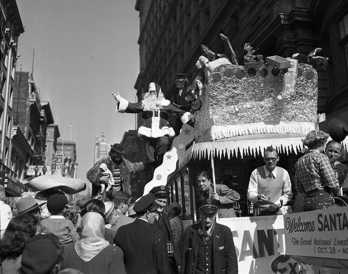 Nov. 18, 1958: Santa Claus arrives at the Emporium in downtown San Francisco after a parade down Market Street.