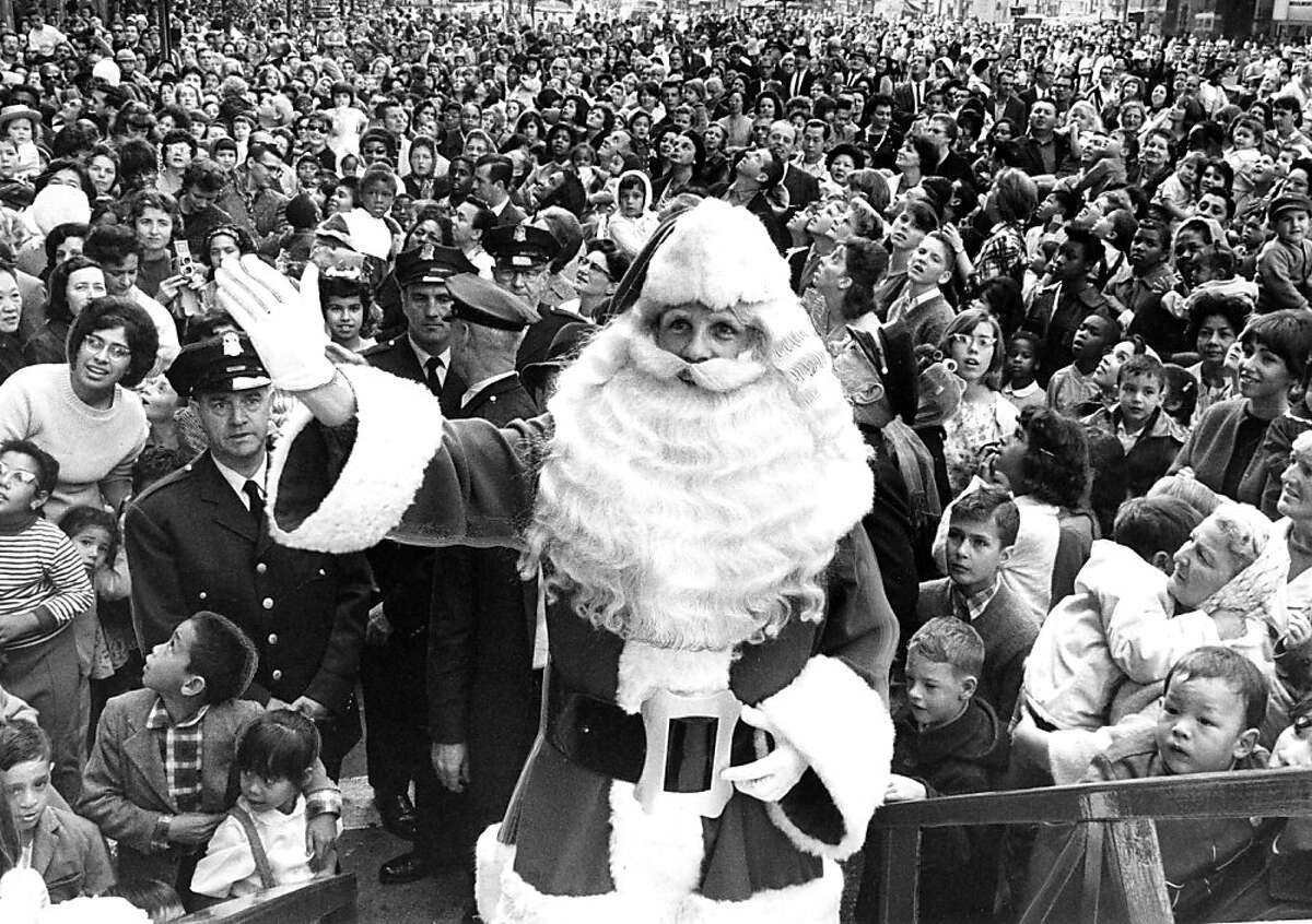 Nov. 7, 1964: Santa Claus gets ready to take his spot inside the Emporium in downtown San Francisco. Thousands of children would attend the parade and festivities.