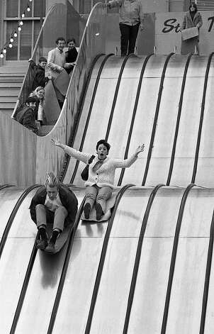 Dec. 17, 1968: Children and adults alike enjoyed the roof slide, one of many entertainments provided on the roof of the Emporium in downtown San Francisco from the 1940s to the 1980s. Photo: Bill Young, The Chronicle
