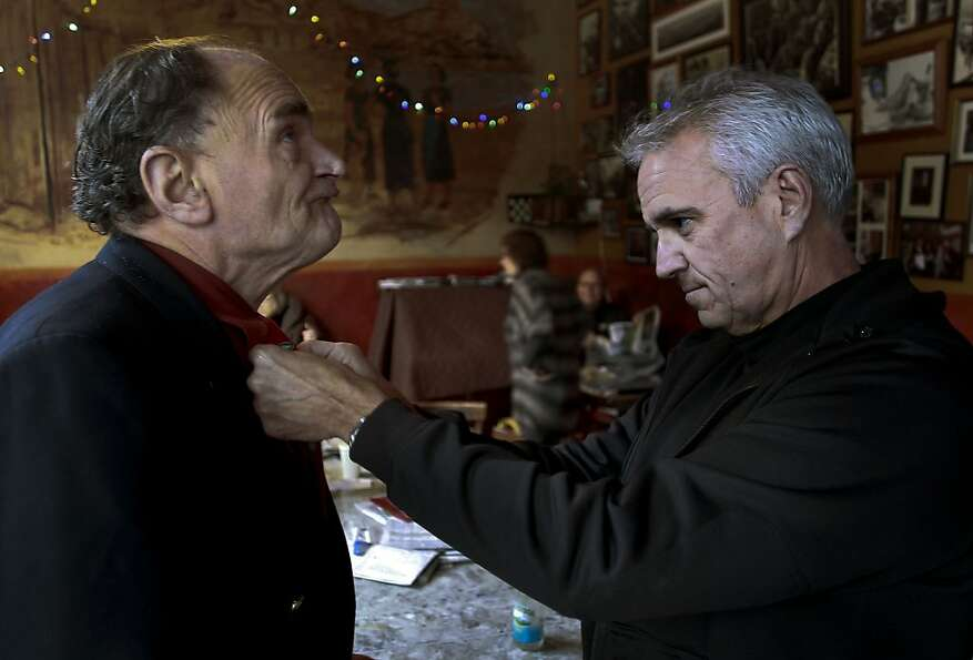 Roy Motini (left) visits Caffe Trieste  with Officer Fred Crisp, who stops to fix his tie. Crisp and