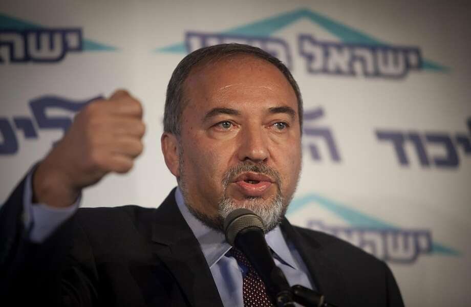 Israel's Foreign Minister Avigdor Lieberman speaks to the media during an event in Tel Aviv, Israel, Thursday, Dec. 13, 2012.  Israel's powerful foreign minister resisted calls to resign after he was charged Thursday with breach of trust for actions that allegedly compromised a criminal investigation into his business dealings, throwing the country's election campaign into disarray just weeks before the vote.  (AP Photo/Dan Balilty) Photo: Dan Balilty, Associated Press
