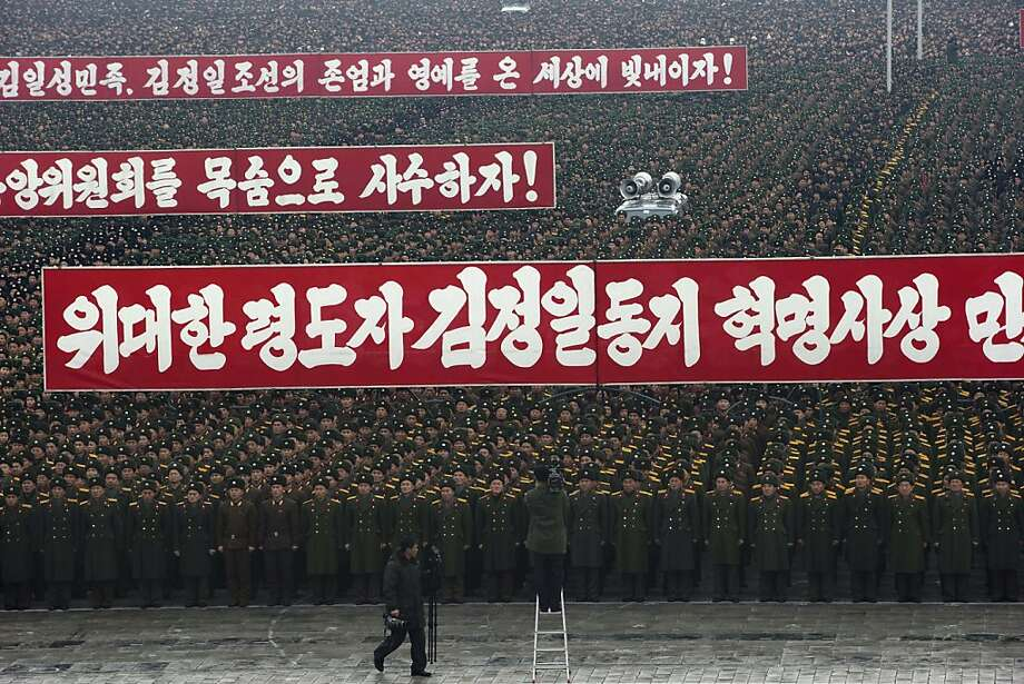 Slogans honoring the leadership are displayed during a mass rally organized to celebrate the success of a rocket launch that sent a satellite into space on Kim Il Sung Square in Pyongyang, North Korea, Friday, Dec. 14, 2012.  As the U.S. led international condemnation of what it calls a covert test of missile technology, top North Korean officials denied the allegations and maintained the country's right to develop its space program. Photo: Ng Han Guan, Associated Press
