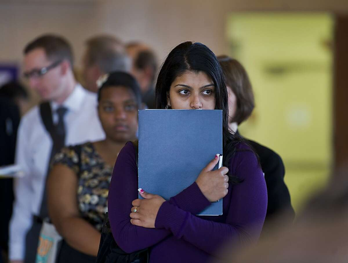 Shelima Din, 23, waits in line to have her resume critiqued on Tuesday, Dec. 11, 2012 in Sacramento, Calif., at the 16th Annual Career Expo at the Masonic Temple building. It featured a long list of job opportunities and dozens of recruiters from a variety of Sacramento area employers, plus expert help with resumes. About 860 jobs were available. (AP Photo/The Sacramento Bee, Renee C. Byer)
