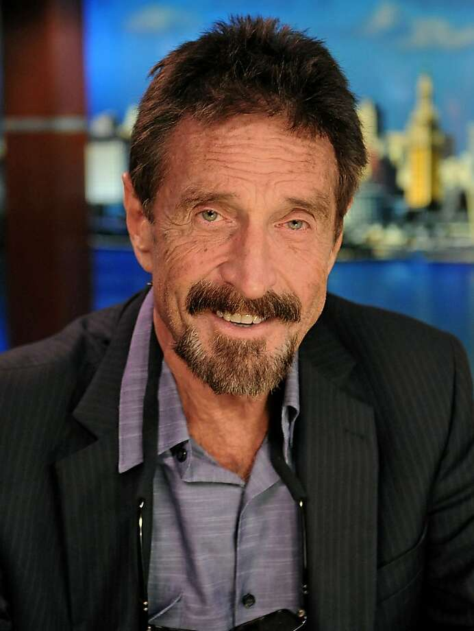 John McAfee is in the United States after being deported by Guatemala. He is still sought by authorities in Belize. Photo: Louis Lanzano, Bloomberg
