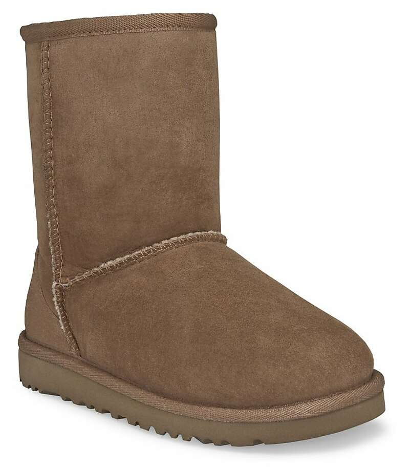 "This undated image provided by Ugg,  shows a Classic Short  Ugg boot in Chestnut color.  A closet full of beautiful boots and gravity-defying heels, flat-foot, furry Uggs weren't at the top of celebrity stylist-designer Rachel Zoe's shopping list. But""Once you put them on, you can't go back,"" Zoe says. ""In my house, it's now the family at-home shoe. I wear them all the time. My son has 10 pairs and my husband has 10 pairs.""  (AP Photo/Ugg) Photo: Associated Press"