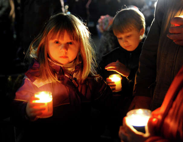 Joanna Rus, 5, and brother  Julian, 8, of Southbury, hold lit candles outside of St. Rose Church as hundreds gather for a memorial service there in Newtown, Conn. on Friday December 14, 2012. Photo: Christian Abraham / Connecticut Post