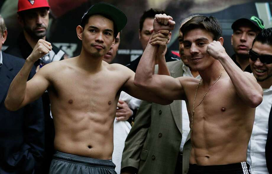 Nonito Donaire, left, will put his World Boxing Organization super bantamweight title on the line tonight at Toyota Center against Jorge Arce of Mexico. Photo: Scott Halleran, Staff / 2012 Getty Images