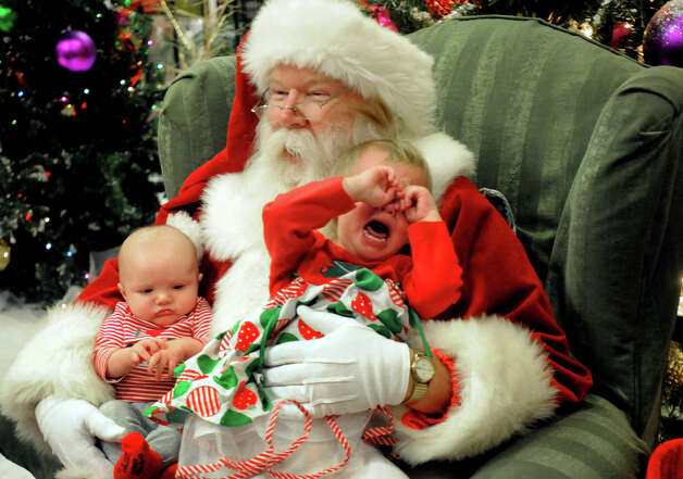 Jonathan Perdew, 3 months-old, left, of Shippensburg, Pa., remains calm while his sister, Olivia, 3, tries to escape from Santa at Chambersburg (Pa.) Mall Thursday, December 13, 2012. Photo:      Ryan Blackwell, Associated Press / Public Opinion