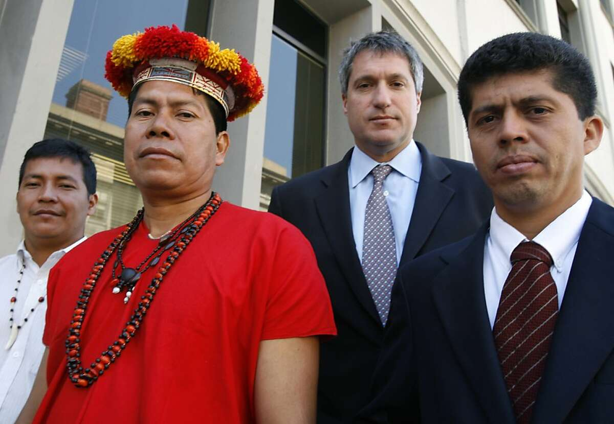Left to right, Ecuadorans Guillermo Grefa and Humberto Piaguaje stand with their legal team Steven Donziger and Pablo Fajardo before a news conference in San Francisco, Calif. on Tuesday, April 24, 2007. The group will press their issue to Chevron shareholders this week bringing to light their accusations that Texaco, acquired by Chevron a fews years back, contaminated an Amazon rain forest region several decades ago.