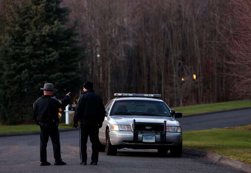 Police block off a section of Yogananda Street near a house belonging to the mother of a man who opened fire inside a Connecticut elementary school, killing 26 people, including 18 children, Friday, Dec. 14, 2012 in Sandy Hook, Conn. Photo: AP