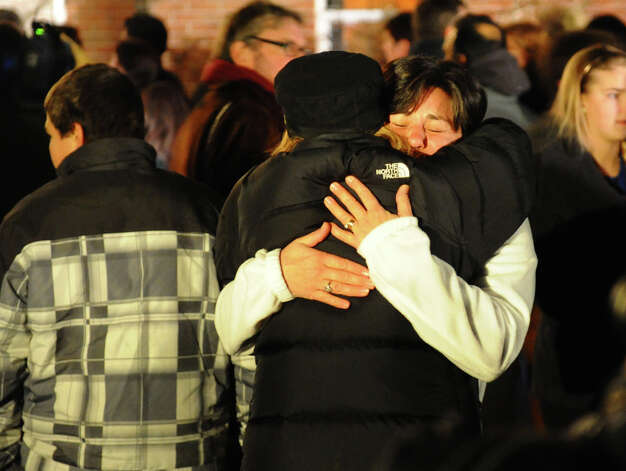 Newtown residents attend a memorial service at St. Rose of Lima Church on Friday, Dec. 14, 2012. Photo: Christian Abraham / Connecticut Post