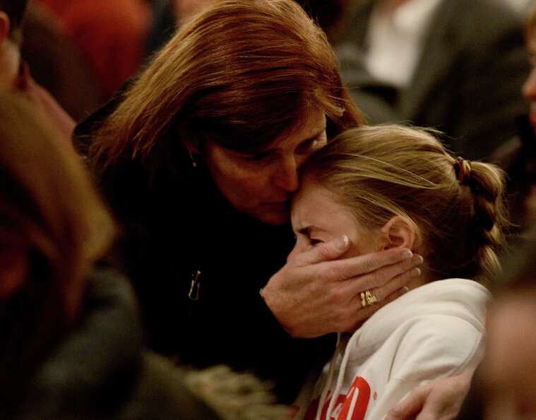 NEWTOWN, CT - DECEMBER 14:  Mourners gather inside the St. Rose of Lima Roman Catholic Church at