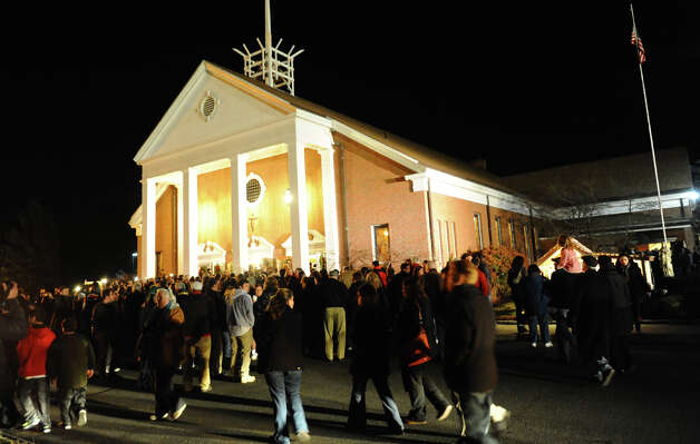 After a horrific shooting at Sandy Hook Elementary School nearby, hundreds of area residents gather for a memorial service at St. Rose Church in Newtown, Conn. on Friday December 14, 2012. Photo: Christian Abraham / Connecticut Post