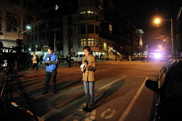 Members of the media line the street where police activity continues outside the apartment of Ryan Lanza in Hoboken, New Jersey, on Friday, December 14, 2012. Lanza's brother, Adam, is the alleged shooter who killed 20 children and 6 adults at Sandy Hook Elementary School in Newtown, Conn. Photo: Niegelberg